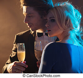 Elegant young couple drinking a champagne