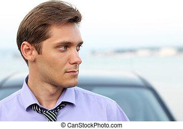 Elegant young handsome man looking away