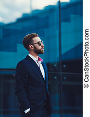 man posing in fashionable suit