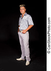 Elegant young handsome man. Studio fashion full portrait.