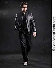 Elegant young handsome man walking