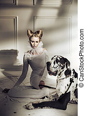 Elegant young lady relaxing with her friendly dog