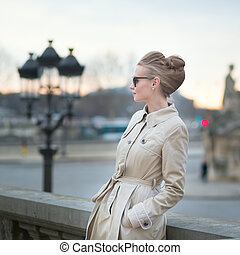 Elegant young Parisian woman outdoors