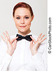 waitress holding on to bow tie