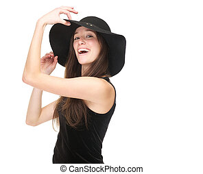 Elegant young woman smiling with black hat
