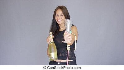 Elegant young woman toasting the New Year - Elegant young...