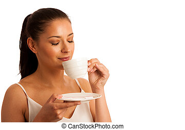 Elegant young woman with a cup of coffee
