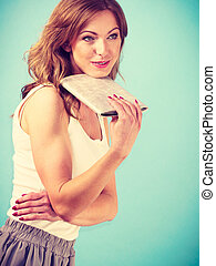Elegant young woman with brown hair having solution for hot...