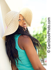Elegant young woman with sun hat