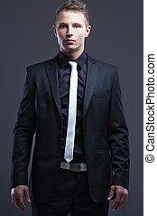 elegante, homem, cinzento, fundo, bonito