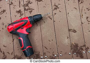 elektrisk drill, på, trä golvbeläggning