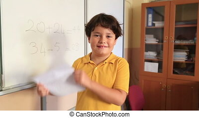Elemantary student in the classroom - Student Showing A...