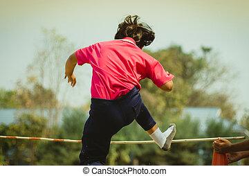 Elemantary  Students Grade 3  take exams High jump.