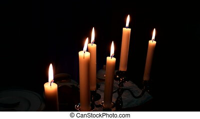 Element of the decor - burning candles in candleholders.