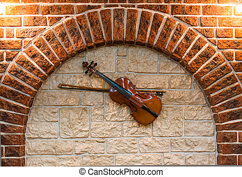 Element of the interior stone arch with a violin
