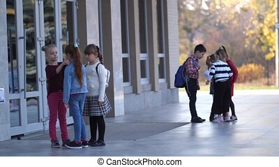 Elementary age students spending freetime outdoors - Groups ...