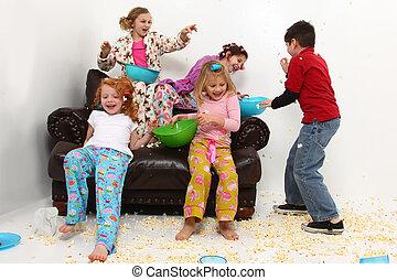 Elementary Girl's Slumber Party Sleepover Having Food Fight