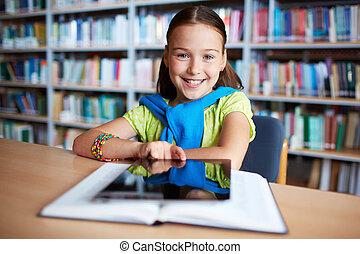 Elementary learner - Portrait of cheerful schoolgirl looking...