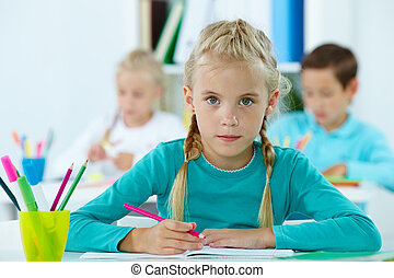 Elementary pupil - Portrait of lovely girl drawing with ...