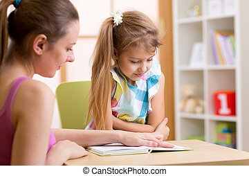Elementary Pupil Reading With Teacher