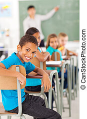 elementary school boy in classroom looking