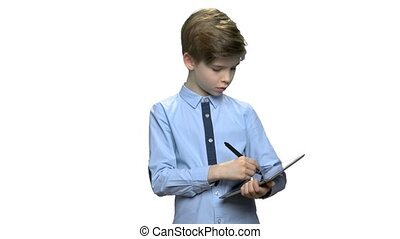 Elementary school boy working on pc tablet. Smart preteen...