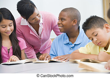 Elementary school clasroom - Teacher working with elementary...
