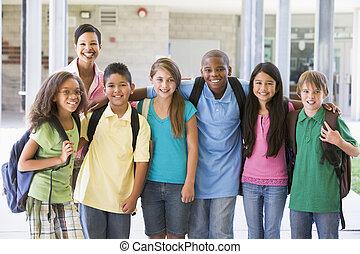 Elementary school class with teacher outside