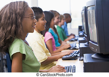 Elementary school computer class - Female pupil in...