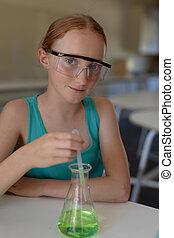Elementary school girl in chemistry class