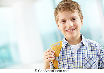 Elementary school learner - Portrait of cheerful schoolboy ...