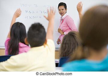 Elementary school maths class with teacher