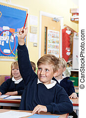 Elementary School Pupil Answering Question In Class