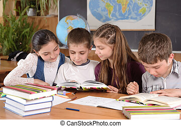 Elementary school pupils - Group of pupils aged 11 study at...