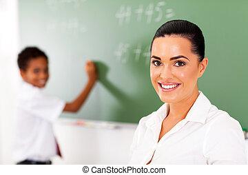elementary school teacher and student