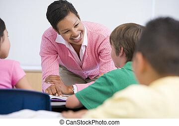 Elementary school teacher with pupils