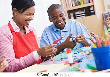 Elementary schoolart class with teacher
