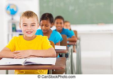 elementary schoolboy with classmates - cute elementary...