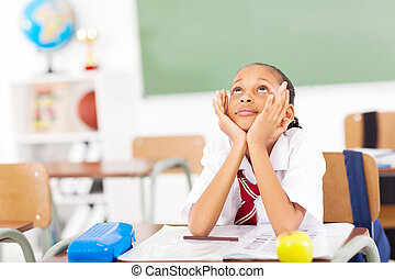 elementary schoolgirl in classroom - young elementary...