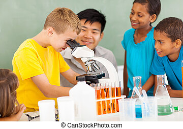 elementary science class - group of students in elementary...
