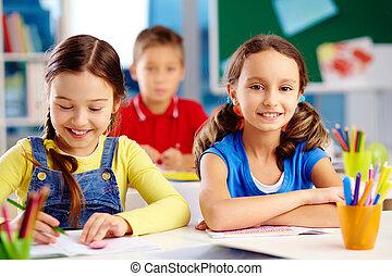 Happy pupils enjoying their day at elementary school