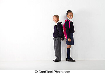 elementary students - two elementary students standing...