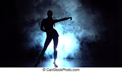 Elements of sport - ballroom dance in the studio, silhouette. Slow motion