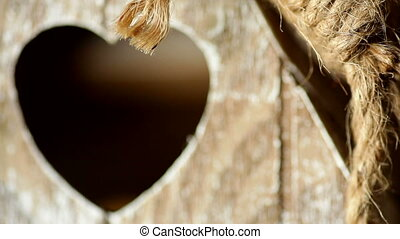 elements wooden candlestick close-up with a window in the form of heart