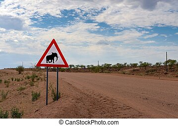 Elephant crossing warning road sign placed in the desert of Namibia
