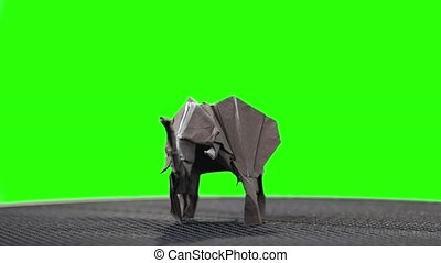 Elephant origami miniature on green screen. Traditional...