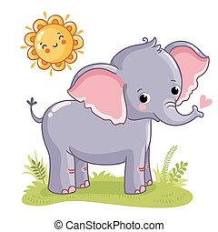 Elephant stands on the sunny meadow.