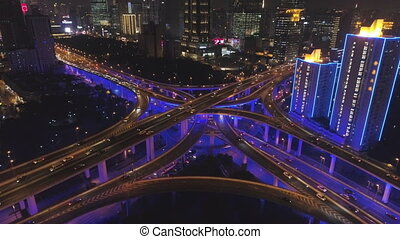 elevated road intersection at night with blue