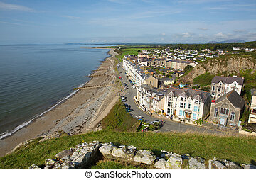 Elevated view Criccieth North Wales UK historic coastal town in summer with blue sky on a beautiful day