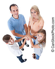 Elevated View Of Family Putting Hands Together Isolated On White Background